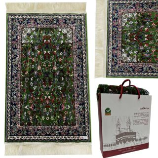 "Green Floral Rawda Masjid An Nabawi Islamic Prayer Mat. Extremely soft with a lovely, soft feel. Makes an ideal gift for a family or masjid where there are many people praying. Present this to someone who prays their five daily prayers and your reward will be ongoing. New design prayer mat based on beautiful Masjid An-Nabawi patterns. The mat weights approximately 650g. Comes nicely packed with beautiful plastic wrap/bag or label wrap. Product of Saudi Arabia by Minwal. Material - Polypropylene & Viscose. Dimensions (approx): 27.5"" X 43.5"""